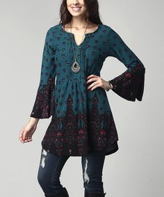 Refresh your tunic collection with this boho-chic pick boasting a notch neck, arabesque print and dramatic bell-sleeves. A lush brushed polyester fabric offers incredible weight and warmth.Note: This is a one-of-a-kind item; prints may vary.Shipping note: This item is made to order. Allow extra time for your special find to ship.
