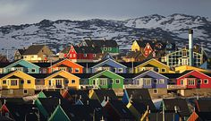 In western Greenland: Houses are painted in bright colors in Ilulissat, 185 miles north of the Arctic Circle. Air Greenland has begun commercial flights from the USA, making the world's largest island more accessible.