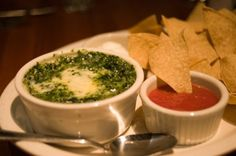 I try to avoid using  To Die For  as a description, but Houston Steak Houses baked Spinach and Artichoke Dip is the best of the best! Houstons serves it hot with tortilla chips, veggies, sour cream and salsa. Recipe courtesy of Houstons Restaurant.