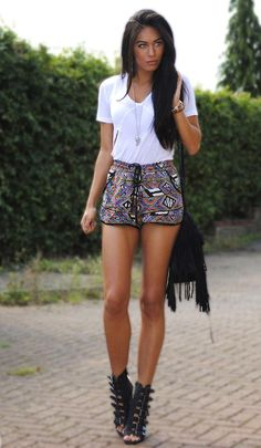 Love the Aztec print dressed up with crazy cool bad ass strappy heels and toned down on top with a basic white tee