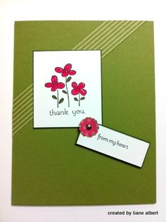 The little scrap strip of pattern paper  and the flower punch really make this simple card pop!