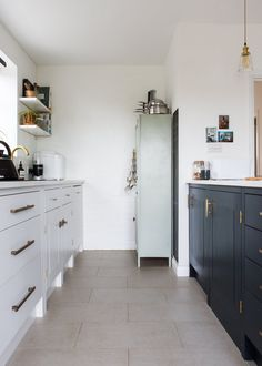 The British Standard kitchen is painted in Farrow & Ball's Ammonite.