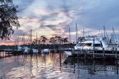 Happy Hour Sunset At Bluewater Bay Marina by Kay Brewer