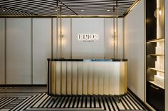 LAANK turns the traditional stark white clinic aesthetic on its head with a bold art deco-influenced interior of black lines and geometric patterns. Clinic Interior Design, Clinic Design, Interior Logo, Wall Logo, Innovation Strategy, Aesthetic Clinic, Counter Design, New Market, Design Thinking