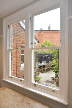 Accoya double timber sash windows by The Sash Window Workshop. The Sash Window Workshop are specialists in replacing timber windows and doors. #windows #timberwindows #windowreplacement #sashwindows #woodwindows #homerenovation #homeimprovement #restoration #renovation