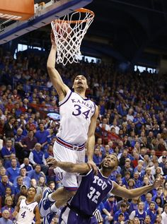 Kansas forward Perry Ellis (34) gets up for a high-flying dunk over TCU guard Trey Zeigler (32) during the second half, Saturday, Feb. 21, 2015 at Allen Fieldhouse.
