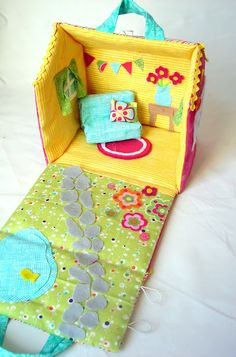 DIY fabric dollhouse. This would be great for a girl box. Because it's fabric, it would fold easily to fit!
