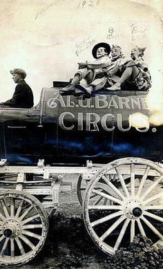 Bert Leo on Al Barnes' Circus Wagon - USA, 1920  Information about Al Barnes' Circus can be found on:     http://www.westland.net/venicehistory/articles/barnescircuszoo.htm