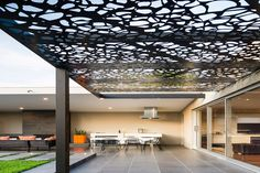 Amazing Modern Steel Pergola Design attached to the House for Patio complete with Dining Table and Contemporary Chairs near Kitchen and Patio Set with Wicker Furnitures - Functional Modern Pergola Design – VizDecor