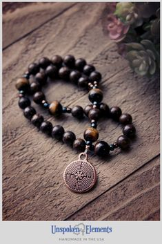 The prayer beads are uniquely handcrafted with bronzite paired with tigers eye gemstones and a double-sided labyrinth charm. This gemstone rosary features a labyrinth and is wonderful to use in your daily prayer and meditation practice to maintain focus, as well as the ideal baptism, confirmation, or healing gift for a family member or friend.  #prayerbeads #anglican #Christianprayer #anglicanrosary Spiritual Symbols, Christian Prayers, Tigers Eye Gemstone, Meditation Practices, Drawstring Pouch, Daily Prayer, Prayer Beads, Confirmation, Thoughtful Gifts