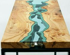 Table with glass. Looks like a stream of water.