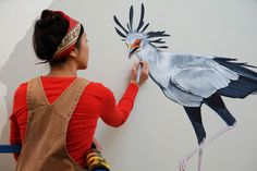 Artist Jane Kim has just completed painting a 3,000-square-foot mural on the wall of the Cornell Lab of Ornithology Visitor Center in Ithaca, New York, that depicts the evolution of birds. A Secretary Bird