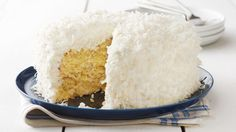 Coconut fans, this dessert is for you. With coconut in the cake batter and frosting, plus a generous coating of shredded coconut to finish it off, this cake is bursting with rich coconut flavor—perfect for any special occasion.
