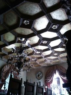 Try this over a weekend; hand finished boiserie surrounding gold leaf lacunaris, with rosettes. Its a mind blower. This ceiling done in by artist Donzine. Rosettes, Gold Leaf, Ceilings, Dining Room, Chandelier, Ceiling Lights, It Is Finished, Interior, Wall