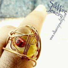Ladybugs & dragonflies love to hang out on SilkWire Jewelry. Why? Because of the natural vibe of gemstones & the Intention of SilkWire Jewelry which is JewelryArt 4 Your WellBeing   #handmade #amber #rings #boho #wirewrapped #gemstone #jewelry #blackowned