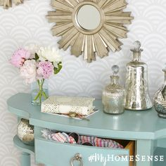 Mercury glass bottles are the perfect finishing touch on a dreamy pastel vanity.