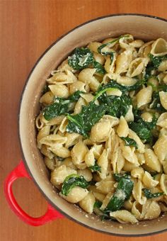 SPINACH RICOTTA PASTA ◦4 Tablespoons salted butter   ◦2 shallots, chopped   ◦5 cups packed fresh baby spinach   ◦1 large egg   ◦1/2 cup ricotta cheese   ◦500 grams conchiglie or large pasta shells   ◦salt and pepper