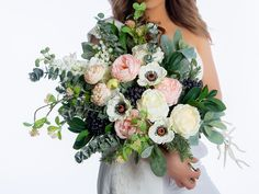 This beautiful Spring bouquet not only looks fresh and realistic but will be a keepsake for a lifetime without the worries of wilting fresh flowers. This boho bridal bouquet is made with high quality silk flowers such as peonies, anemones, succulents, lily of the valley, delphinium, eucalyptus, lamb's ear and greenery. Anemone Bridal Bouquet, Flower Girl Bouquet, Bouquet Toss, Spring Bouquet, Flower Girl Basket, Bride Bouquets, Flower Bouquet Wedding, Bridesmaid Bouquet, Fresh Flowers