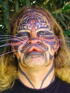 Stalking Cat - Dennis Avner an American man known for his extensive body modifications, which were intended to increase his resemblance to a female tiger