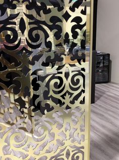 Gorgeous gold mirrored ACM 'Morocco' decorative screen by Australian wholesalers QAQ Decorative Screens and Panels.