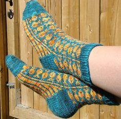 Ravelry: Swedish Fish Socks pattern by SpillyJane