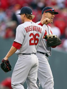 Matt Holliday  and Trevor Rosenthal  celebrate after the Cardinals 1-0 win over the Cincinnati Reds on Opening Day.  3-31-14