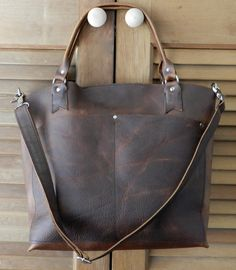 I once got a leather bag in an ugly color brown that I really didn't like. My dad gave it to me so I couldn't throw it away. So I instead applied oil and it came into this nice dark brown color, like this one. It was love! Oil tanned rust distressed leather tote bag. $175.00, via Etsy.
