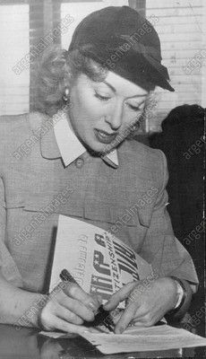 """This photo may have been taken at Garson's citizenship ceremony (1951). See the writing on the folder she is holding: """"Welcome to a U.S.A. Citizenship..."""""""