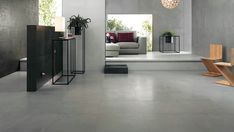 This living room looks smooth with porcelain tiles from our Evolve series. | Type of tile: Porcelain | Series: Evolve | Usage: wall and floor commercial and residential | colour: Concrete