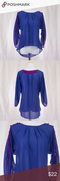 Sheer High Low Blouse Cute blue top with purple piping and buttons along sleeves. Material is 100% polyester. Tops Blouses
