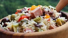 "Insalata di Riso (Italian Rice Salad) I ""Add a few drops of your favorite hot pepper sauce for a dash of spice if you like. Many Italians add a few tablespoons of mayonnaise at the end."""