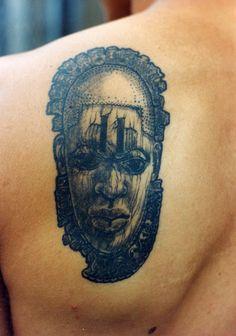 African Tattoo On Back Shoulder