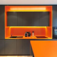 Grey Kitchen Cabinets Orange Countertop Orange Background Wall Hidden Lighting Knives Stainless Steel Sink Electric Stove Vibrant and Fresh Décor Ide. Kitchen Cabinets Orange, Orange Kitchen, Küchen Design, Layout Design, House Design, Desgin, Cocinas Kitchen, Cuisines Design, Office Interiors