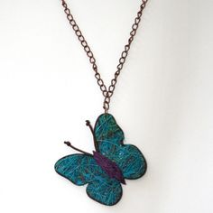 Dream of running through a field of fluttering butterflies in this necklace.