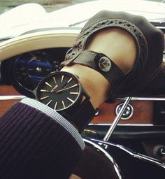 Driving gloves and watch; black and brown.