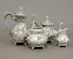 A good Victorian ornate silver plated four piece tea service… -by Boardman Glossop & co Sheffield and London