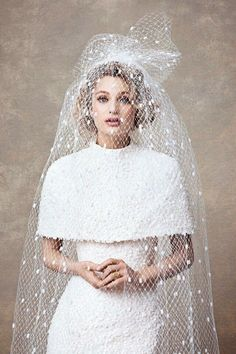 I love the dress itself, but I would pick a different veil. Because the veil and the shawl together do not work for me.