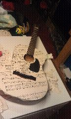 mod podge guitar with 1950s  sheet music!