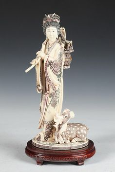 JAPANESE IVORY OF OKIMONO GEISHA AND DEER. - 12 in. high.