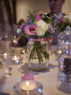 Flowers and candles for beautiful and cheap centerpieces. I like the idea of Mason jars for vases. Simple Centerpieces, Candle Centerpieces, Wedding Centerpieces, Wedding Table, Diy Wedding, Vases, Wedding Decorations, Purple Centerpiece, Centerpiece Ideas
