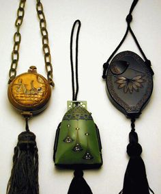 Three Art Deco Vanity Purses 1920s  Each celluloid, one black, with red stones, one etched with woman in Oriental costume, the third faux jade with blue stones, two with silk cord.  Sold for $2,000 (Includes Buyer's Premium) Estimate $ 1,000-1,500