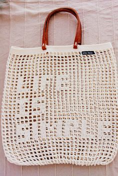 "Versatile, amazing and stylish crochet shopping bags. The crochet bags are made with the ""filet crochet"" technique. The bags look delicate but at the same time they are sturdy. The handles are made of leather."