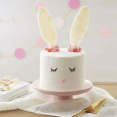 With dreams of jelly beans, chocolates and colorful candy eggs, this Sweet Easter Bunny Cake can't wait for your Easter celebration!  A sweet Easter dessert that is easy for decorators of all skill levels, this Easter bunny cake features simple decorations and has sparkly candy ears that are sure to catch everyone's eye.  Also fun for baby showers or birthday parties, this bunny cake is just as sweet to look at as it is to eat!