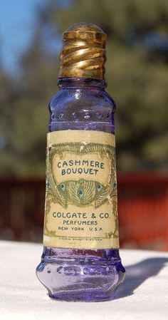 *Original antique COLGATE Co CASHMERE BOUQUET Perfume bottle. Nice & purple, embossed and labeled, orig brass and cork cap.