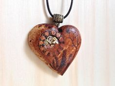 Outlander Heart Pendant with Steampunk Clock and Craigh Na Dun .. and a Dragonfly in Amber on the backside.