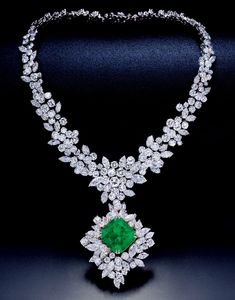 A 28.28 CARAT NO OIL COLOMBIAN EMERALD & DIAMOND NECKLACE, BY VAN CLEEF & ARPELS. The pendant set with a detachable cushion-shaped emerald weighing 28.28 carats, framed by diamonds, suspending from a necklace set with brilliant-cut, and marquise-shaped diamonds, diamonds weighing 76.70 carats, mounted in 18K gold. Signed Van Cleef & Arpels no. 87448.