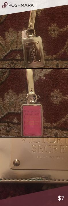VS key chain or luggage tag Gold with sequenced handle. Can be used as a gift card holder,  key chain, ID holder, gym pass or luggage tag. Still has tags. One small area has blue color on seam. Pictured. Victoria's Secret Accessories Key & Card Holders