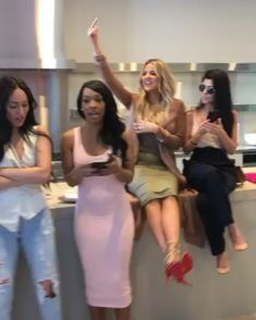 Pin for Later: Chrissy Teigen's Shower Dress Is So Perfect, It's Impossible to Peel Your Eyes Away From the Screen For Footwear, Chrissy Opted For Neutral Pumps, Which Paired Perfectly With the Piece And her dancin' friends didn't look too shabby either!
