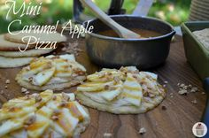Mini Caramel Apple Pizzas! Brandon would love these. I bet they would be even better with snicker doodle cookies instead of sugar cookies