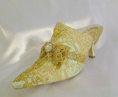 Marie Antoinette themed wedding shoes in pale green and  gold sparkles. $305.00, via Etsy.